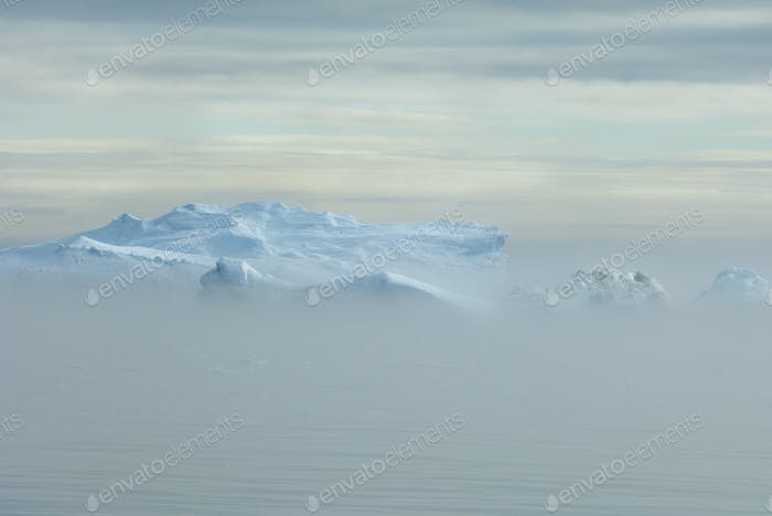 View over the iceberg and land mass off Baffin Bay in Greenland.