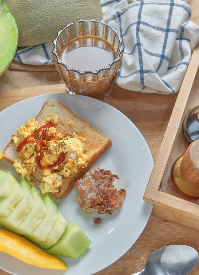 The homemade breakfast with a cup of coffee