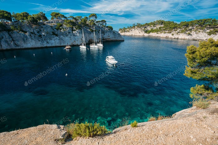 Yachts Boats In Bay. Calanques - A Deep Bay Surrounded By High C