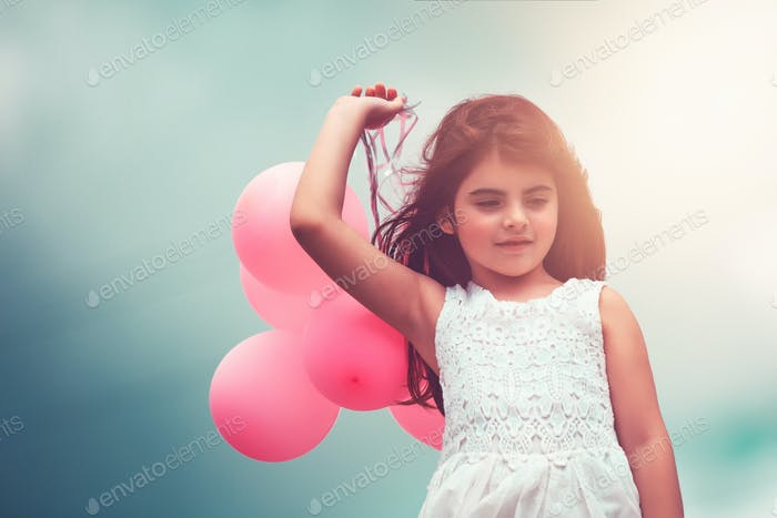 Happy girl with air balloons