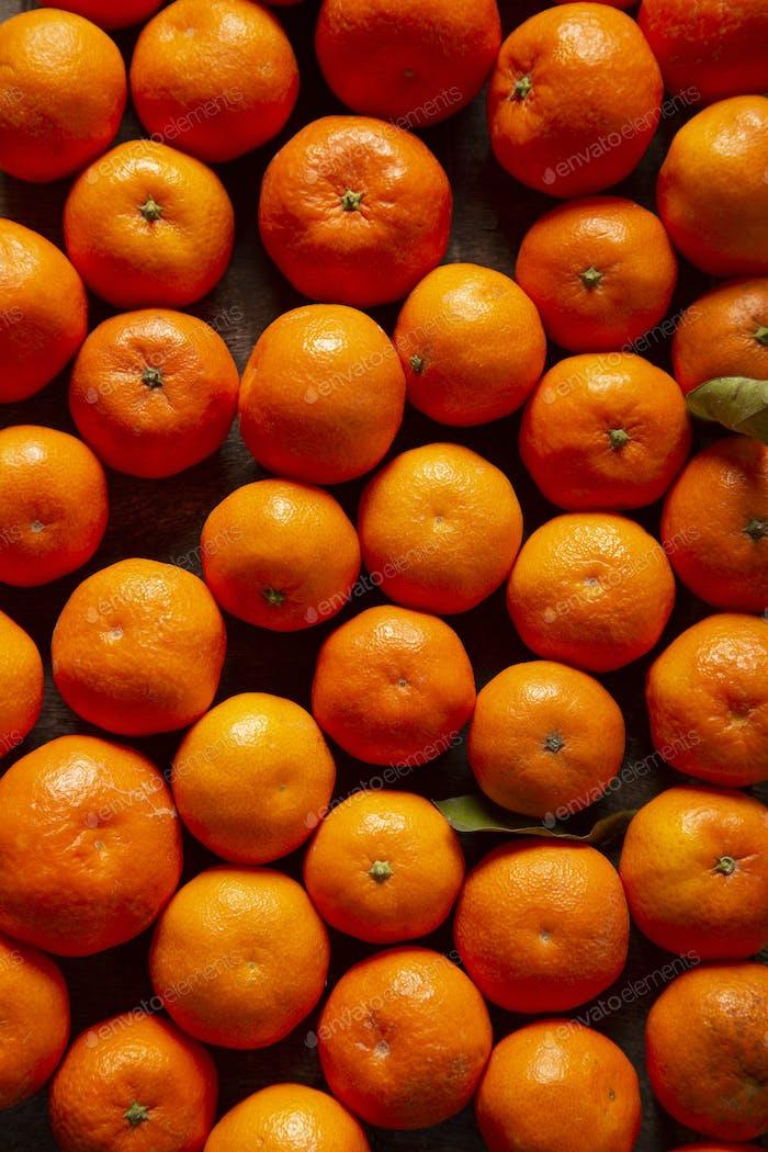 Fresh and ripe tangerines, orange background, tangerine background fruit, vitamin c, tropical fruit.