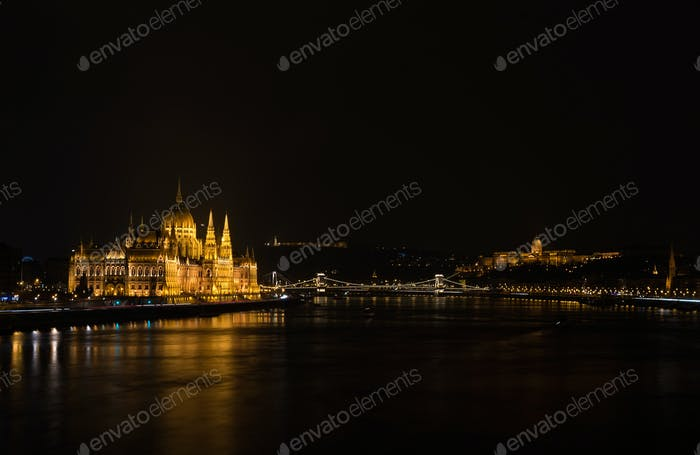 View of Hungarian Parliament Building, Royal Palace and Danube  river from Margit bridge at night.