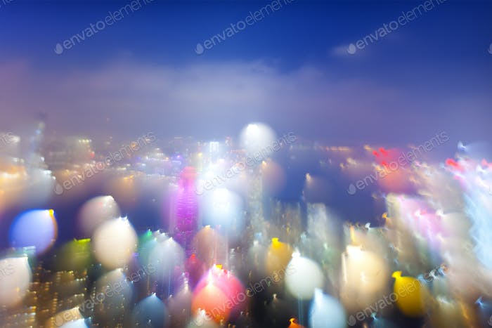 Night Aerial View of Blurry Cityscape with Lights