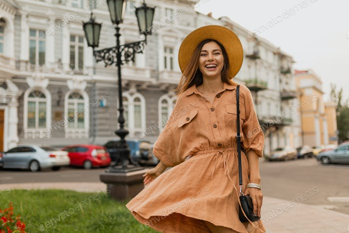 stylish young woman dressed in spring trendy dress