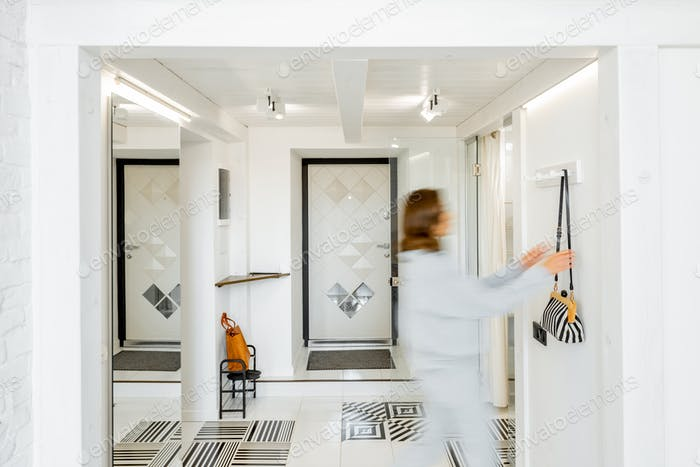Apartment hallway with blurred human figure