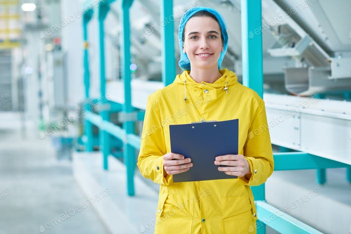 Cheerful Young Woman at Factory