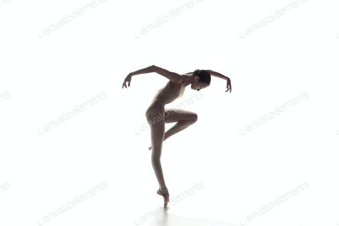 Ballerina. Young graceful female ballet dancer dancing isolated on white. Beauty of classic ballet.