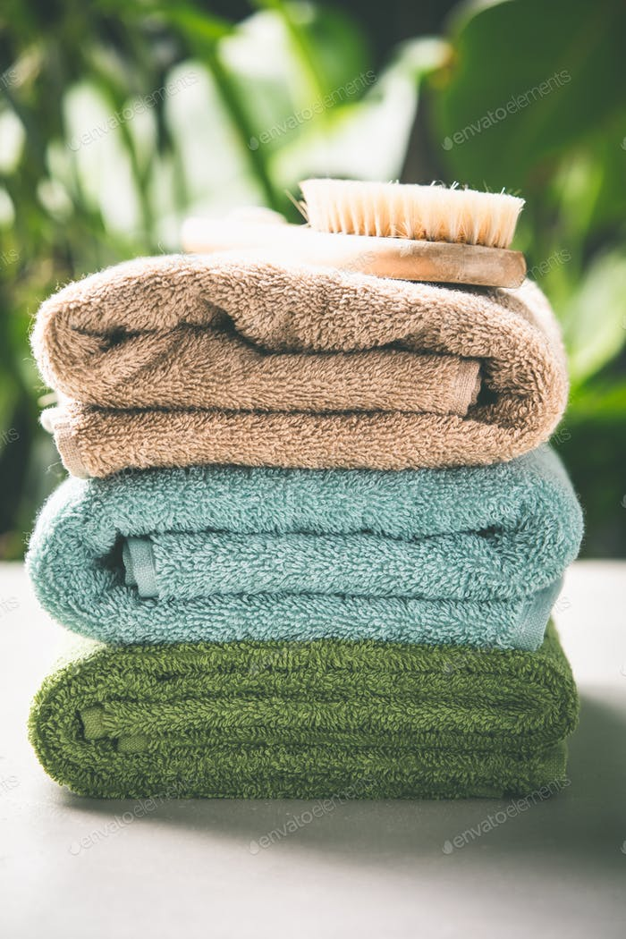 Towels on tropical leaves background