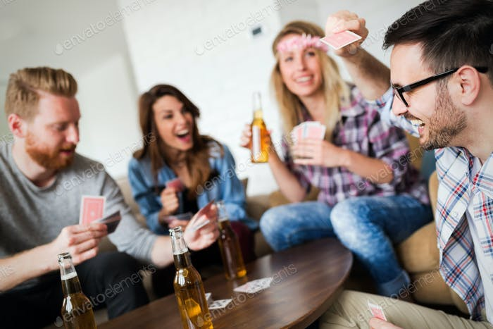 Cheerful friends having party and drinking beer