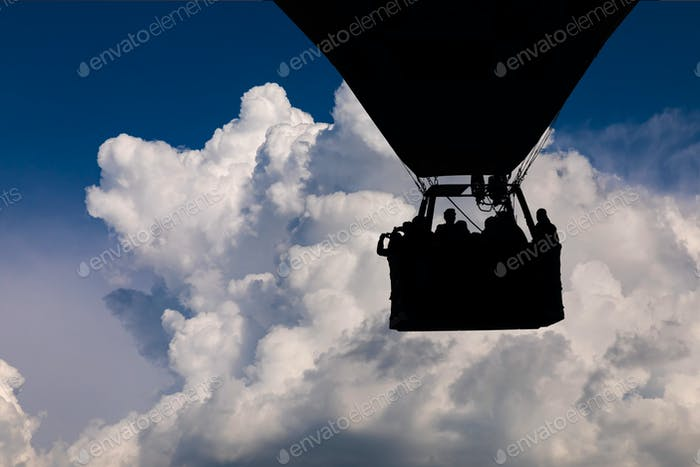 Hot air balloon flying on a beautiful cloud background
