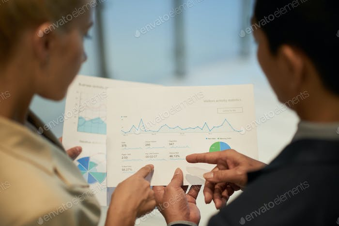 Business people analyzing data