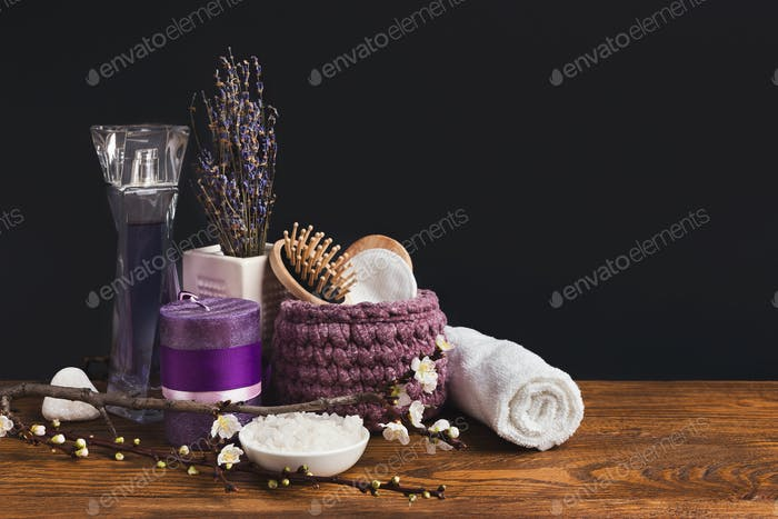 Spa composition with lavender and candle on table