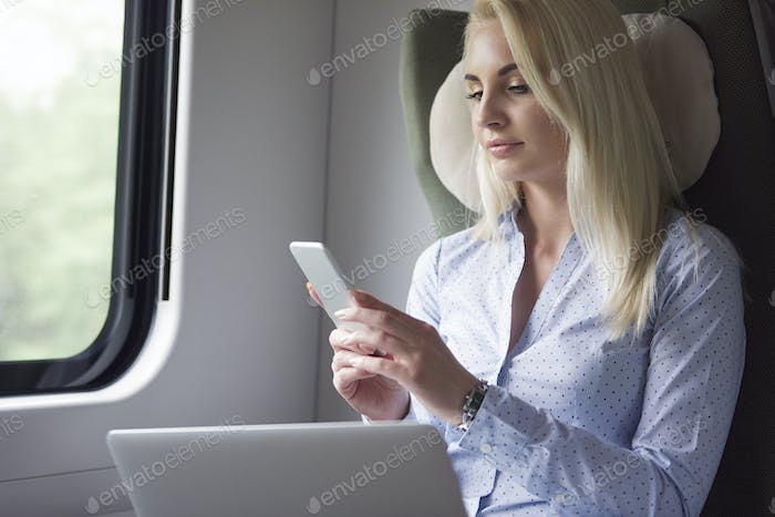 Businesswoman working by mobile devices during the travel