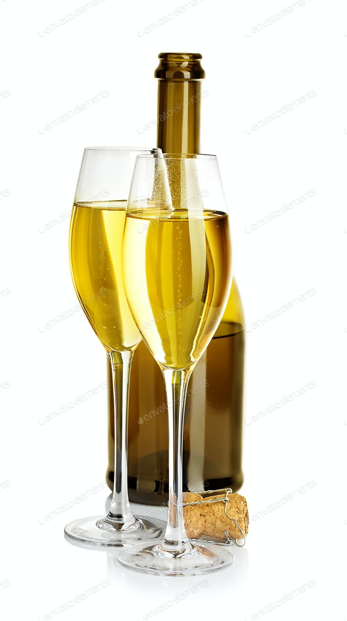 Two glasses of champagne on the background of brown bottles close-up isolated on a white.