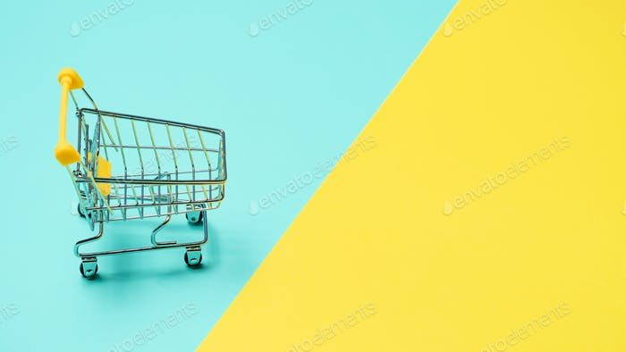 Empty inverted shopping cart, copy space