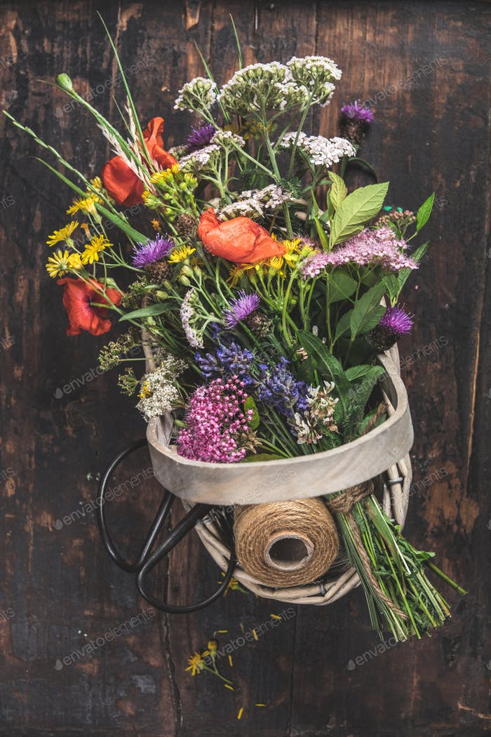 Bouquet of wild flowers in a basket
