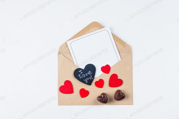 Valentines day mockup. Love card. Paper card with envelope and chocolate candy. Flat lay, top view