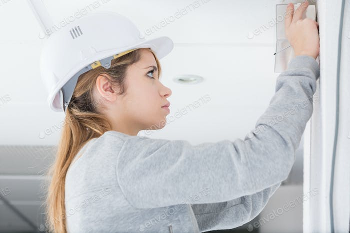 young woman doing diy with a helmet