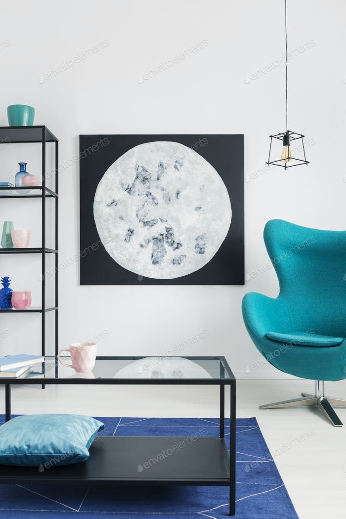 Blue egg chair in bright living room