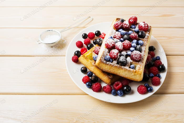 Belgian waffles with blueberry, raspberry and ising sugar