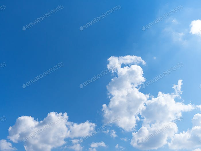 Beautiful blue sky with bright white clouds