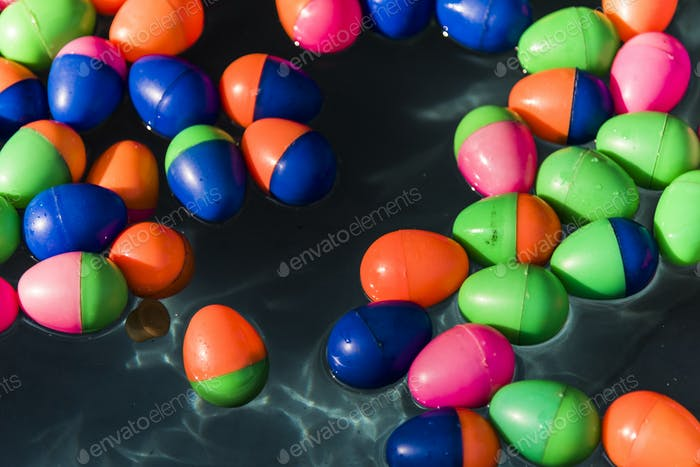 Plastic eggs floating in water