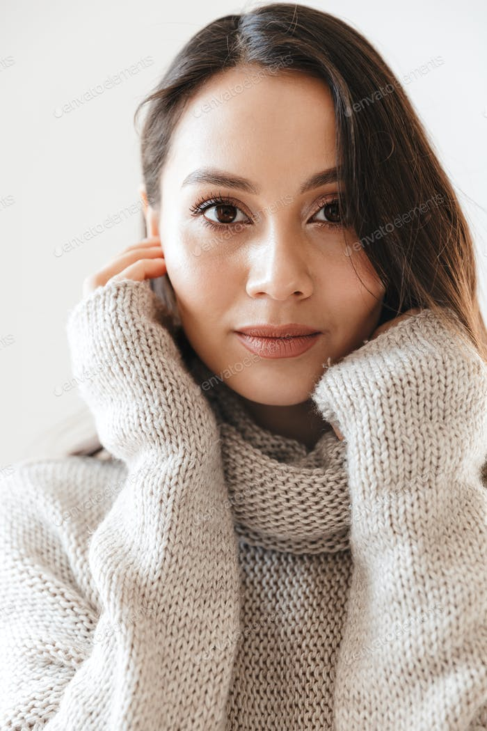 Image of confident asian woman posing and looking at camera