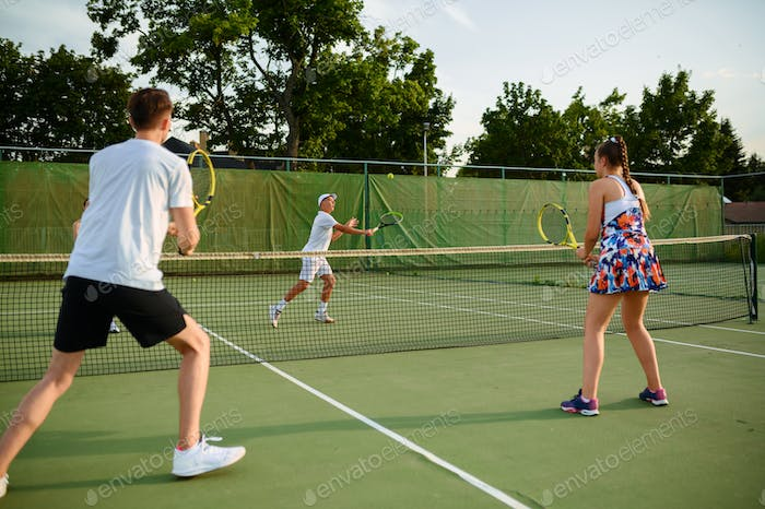 Mixed doubles tennis players, outdoor court