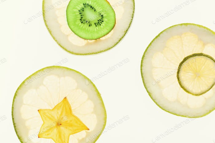 Backlit citrus fruits slices background