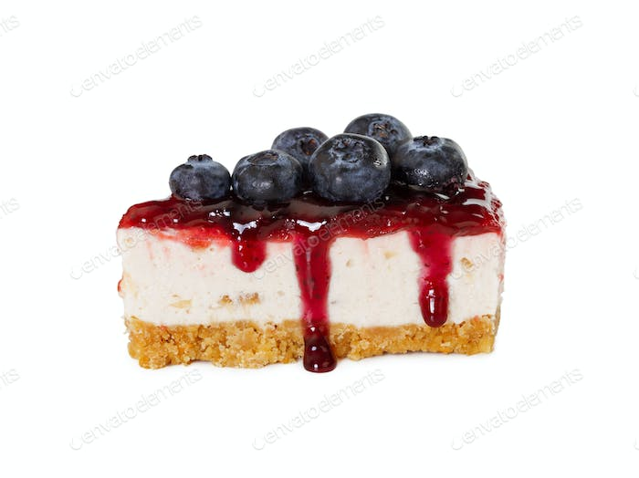 Piece of cheesecake with jam and fresh blueberries