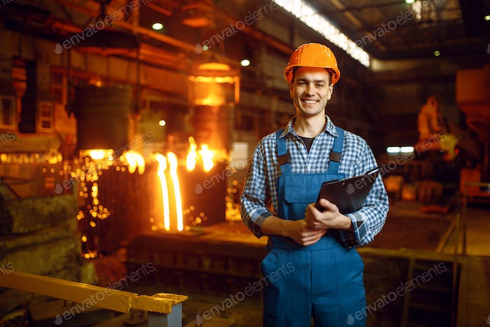 Master at furnace with liquid metal, steel factory