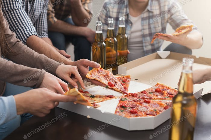 Hands of friends taking slices of tasty pizza at home