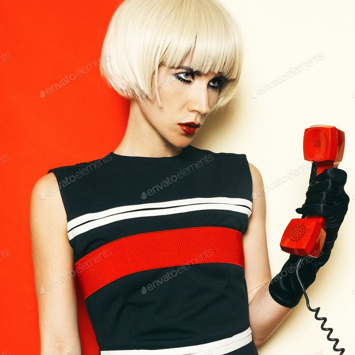 Blonde Sexy retro style with vintage phone and vintage clothing.