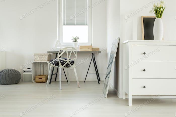 Wooden desk in white room