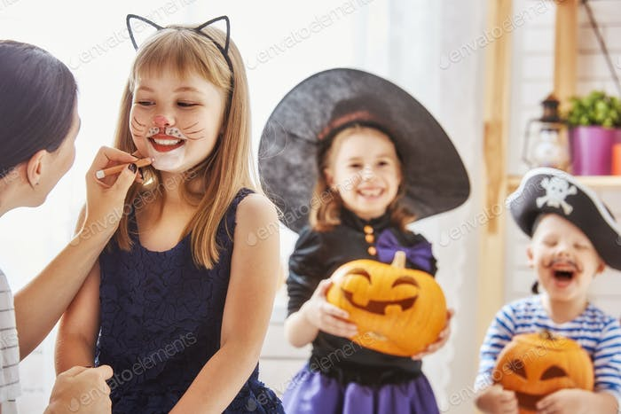 family prepares for Halloween