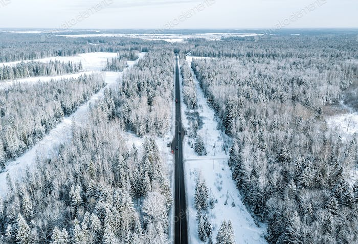 Aerial view of snow covered road in winter. Winter landscape.