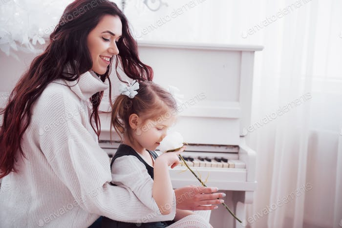 Happy loving family. Mother and her daughter child girl playing together