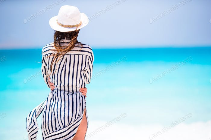 Young beautiful girl on the tropical beach