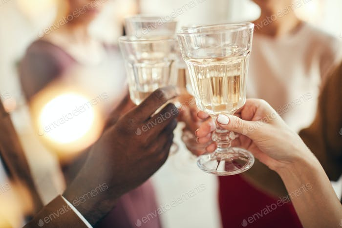 People Toasting at Christmas Party Closeup