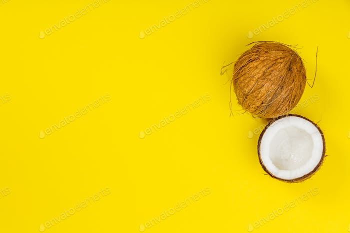 Coconuts on yellow background
