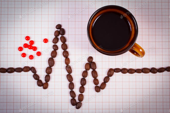 Cardiogram line of coffee grains, cup of coffee and supplement pills, health care concept