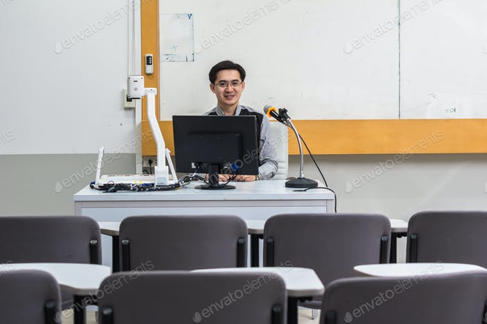 Portrait of Asian teacher in the classroom, University education concept