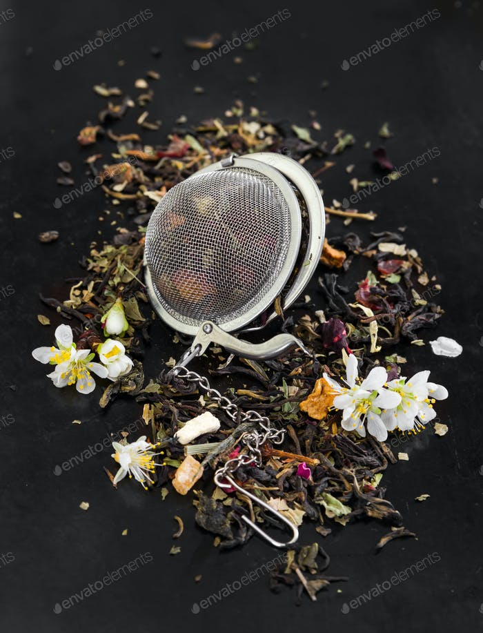Herbal tea with flowers in tea strainer