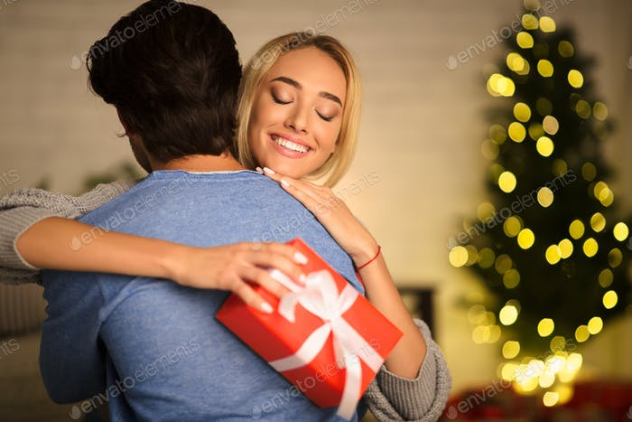 Happy wife embracing man, being thankful for present