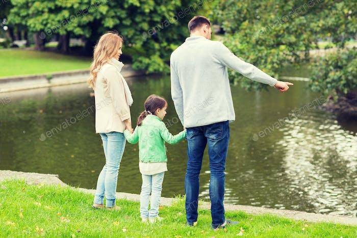 family walking in summer park