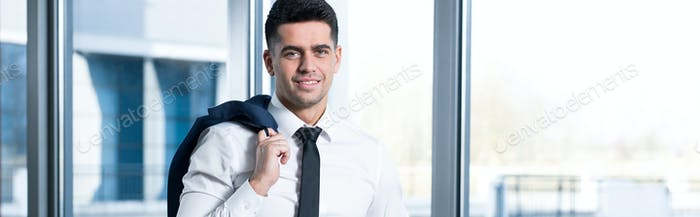 Young smiling businessman without a jacket
