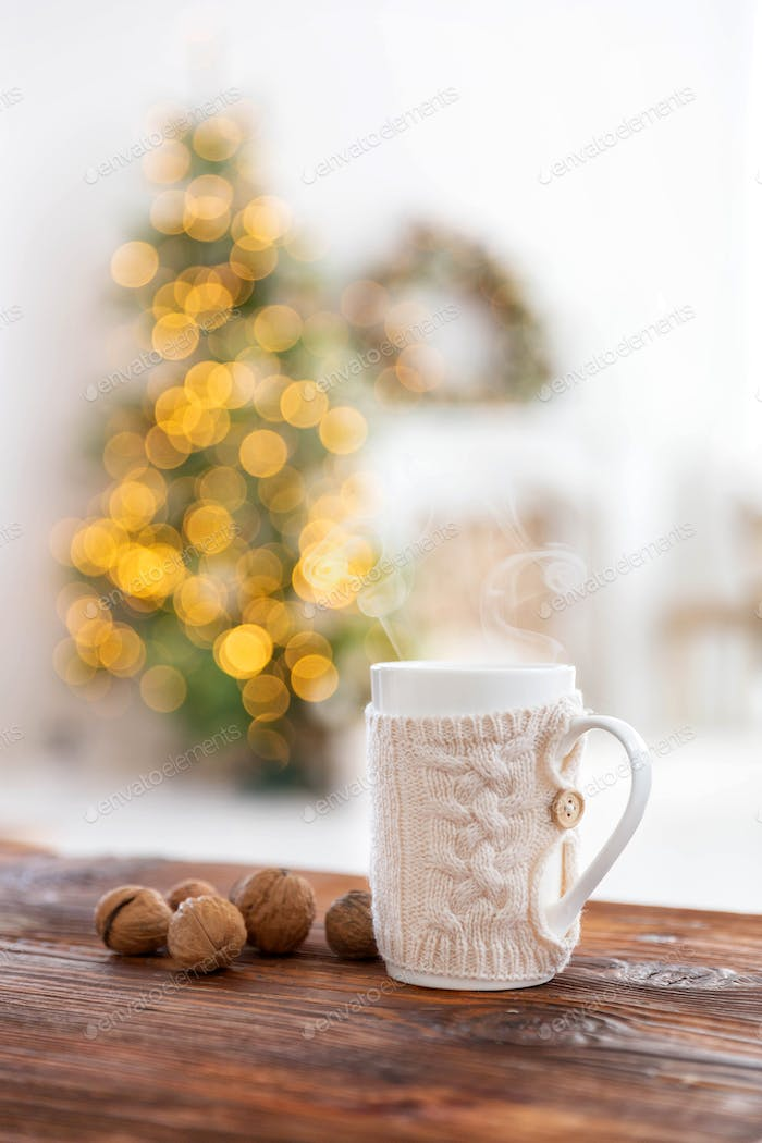 Cup of warm beverage on the Christmas background