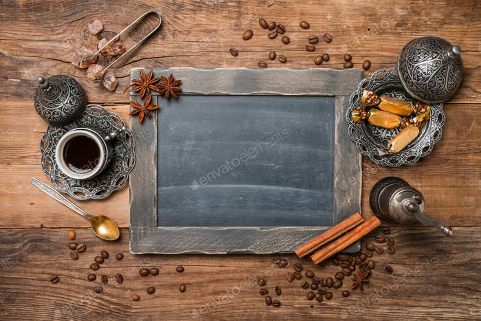 Cup of coffee and chalk board menu