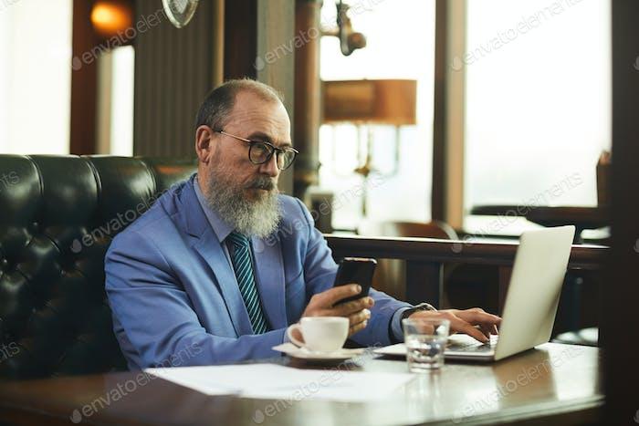 Senior businessman in cafe