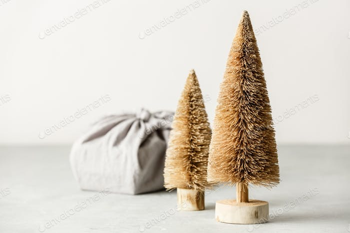 Fabric wrapped gift and coconut fiber Christmas trees